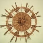 Naścieny wiklinowy element dekoracyjny w kształcie koła