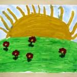 Praca plastyczna - słońce i łąka z kwiatami
